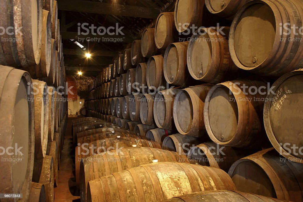 A wine cellar with many barrels of wine inside them royalty-free stock photo