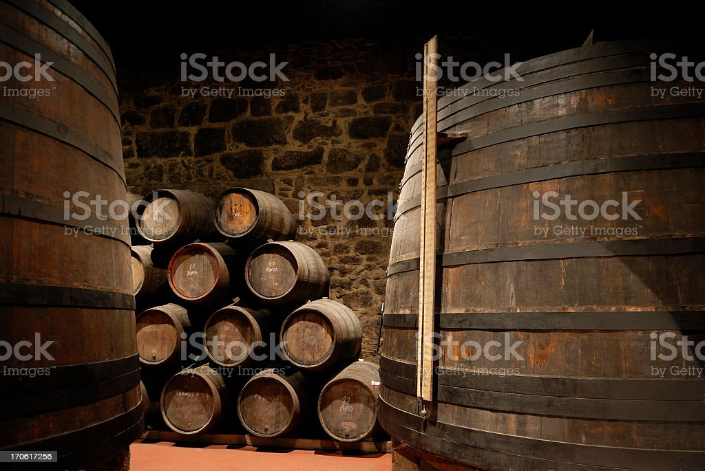Wine cellar with stacked wine barrels stock photo