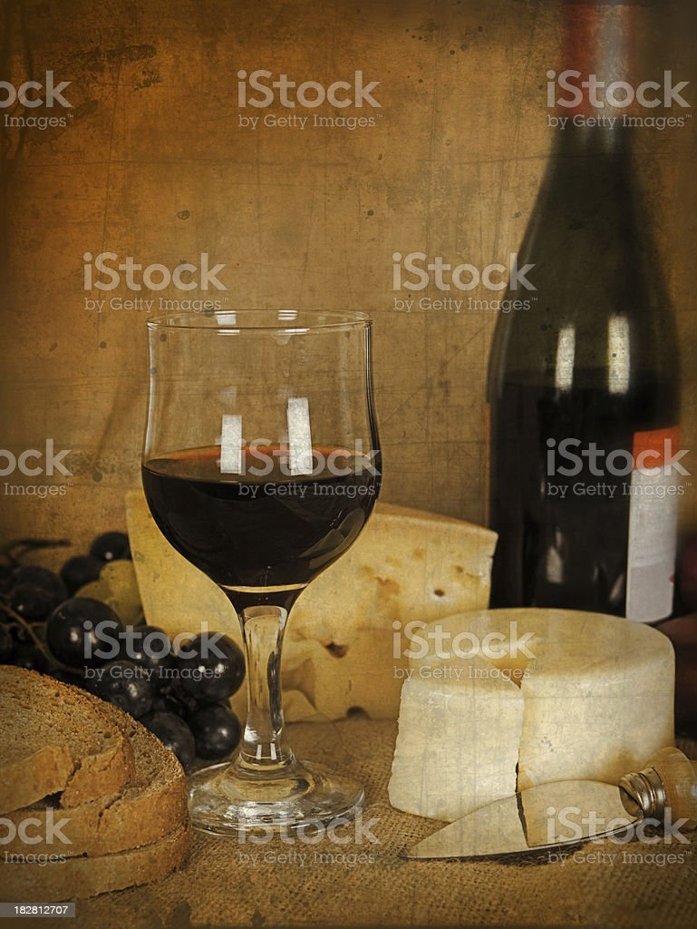 Wine, cheese and grapes with vintage look royalty-free stock photo