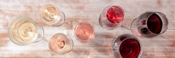 Wine color panorama with many different glasses, a flat lay stock photo