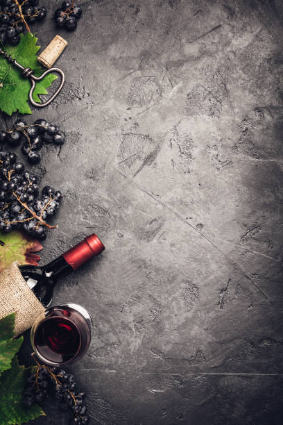 Wine composition on dark rustic background stock photo