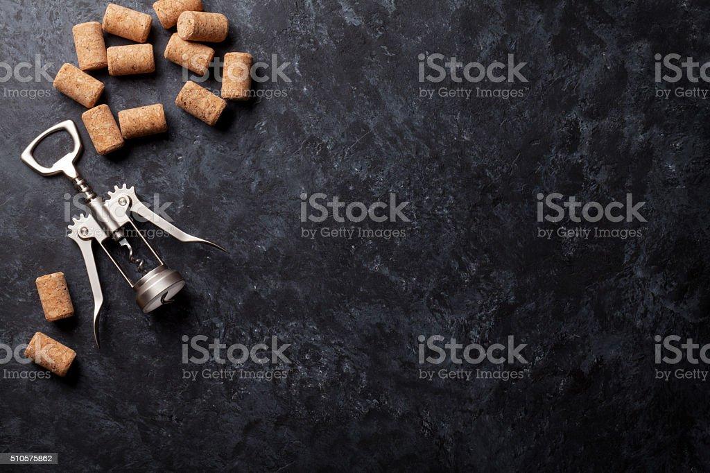 Wine corks and corkscrew stock photo