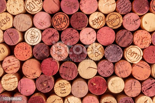 istock Wine corks background, overhead photo of red and white wine corks 1023496540