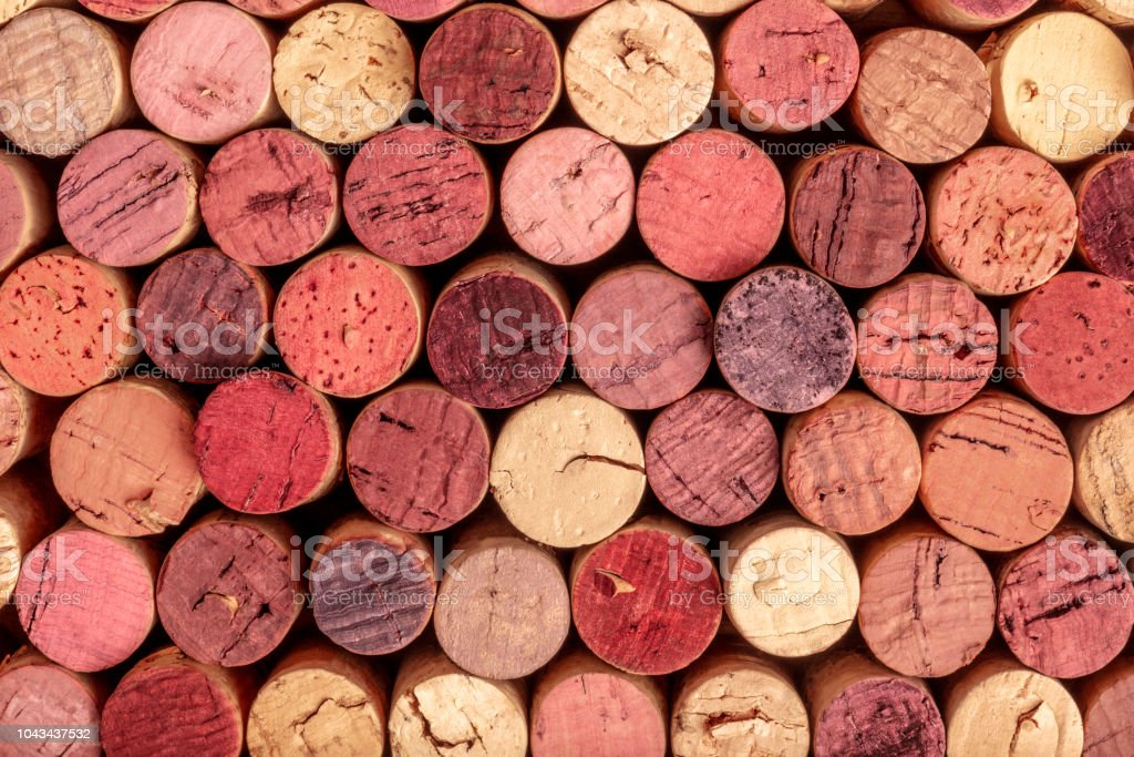 Wine corks background, overhead photo of red and white wine corks stock photo