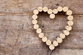 Wine corks form a heart shape on the wood board