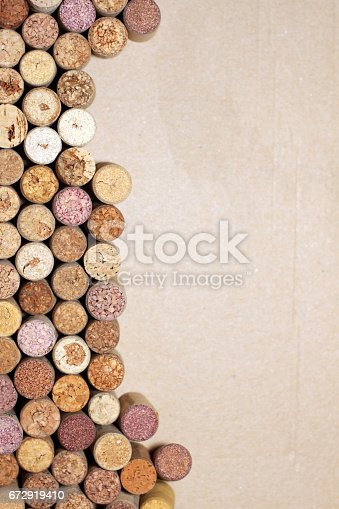istock Wine corks on paper background for your text 672919410