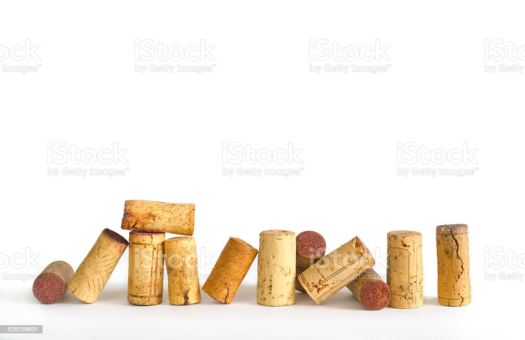 wine corks on white background, free copy space stock photo