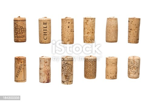 Clipping paths included to all corks. Large group of different wine corks isolated on white background.