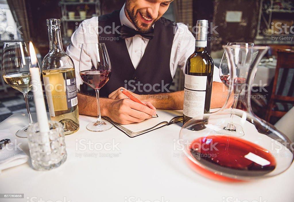 Wine critic is in good mood stock photo