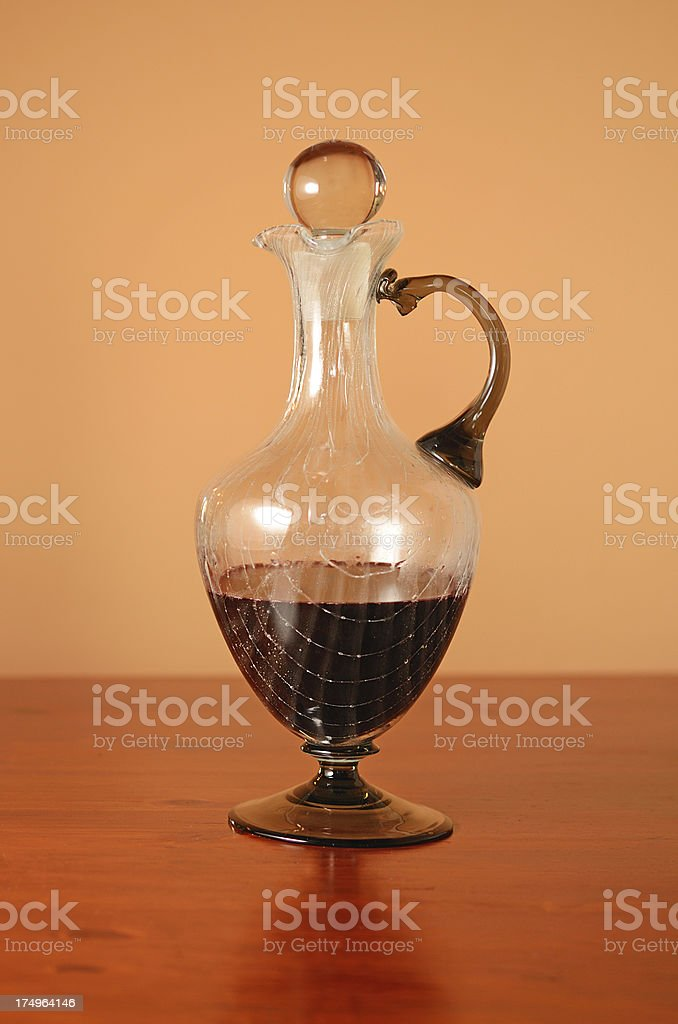Wine decanter on brown wood table royalty-free stock photo