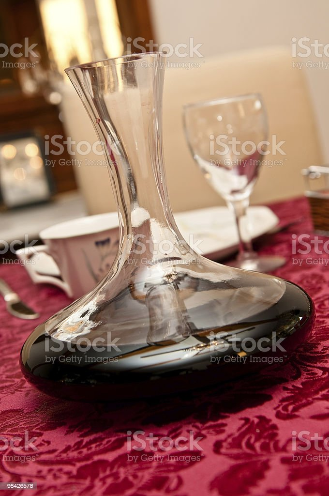 Wine decanter over a dinning table royalty-free stock photo
