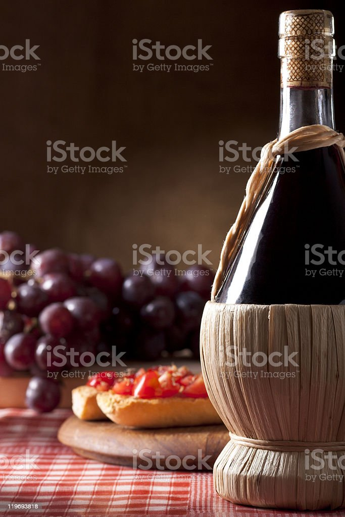 Wine Flask with Bruschetta and Grapes royalty-free stock photo