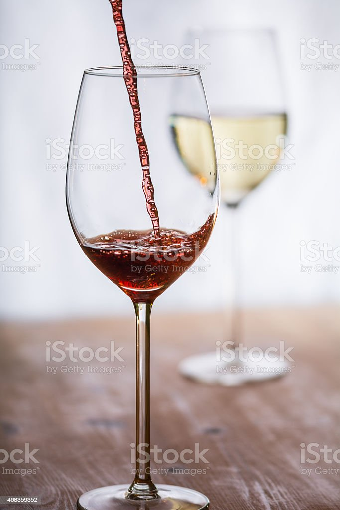 Wine gets filled into a glass royalty-free stock photo