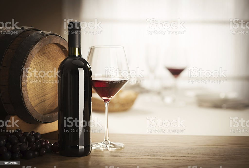 Wine glass and bottle still life stock photo