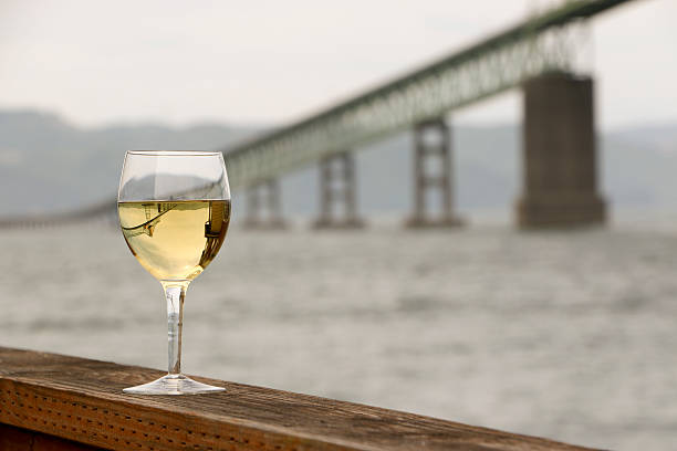 Wine Glass Chardonnay Reflection Astoria  Bridge Columbia River Oregon Washington stock photo