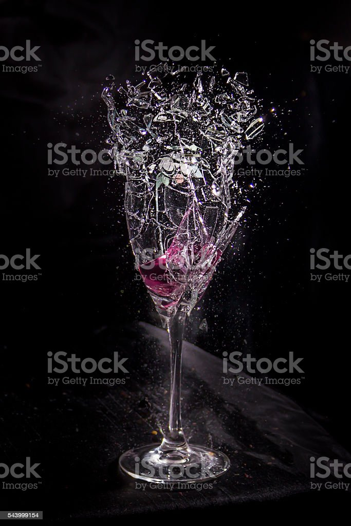 Wine glass exploding/shattering stock photo
