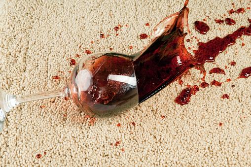 istock Wine Glass Falls onto Carpet 171251057