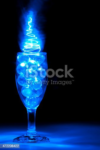 istock Wine Glass filled with Clear Marbles with Blue Light Painting 472206422