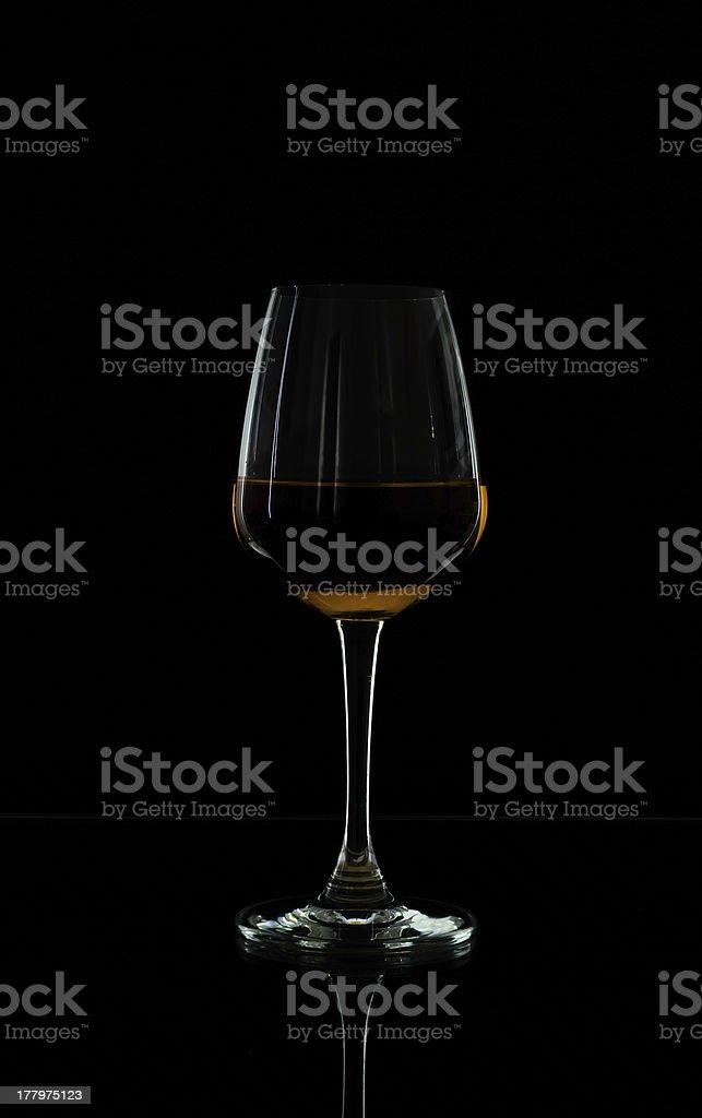 Wine glass in blackdrop royalty-free stock photo
