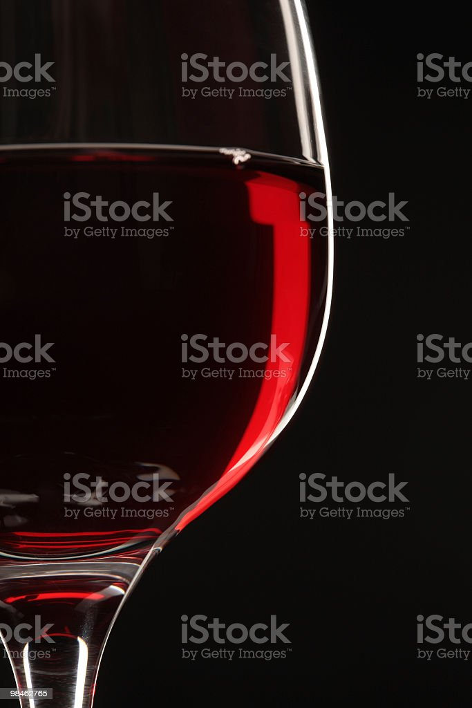 Wine glass on a black background royalty-free stock photo
