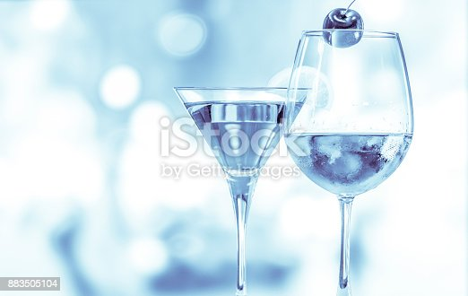 istock Wine glass on the circle light bokeh background with blue color 883505104