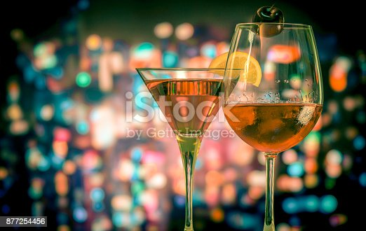istock Wine glass on the circle light bokeh background with vintage style 877254456
