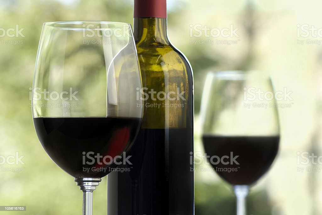 Wine glasses and a bottle containing Cabernet wine  royalty-free stock photo