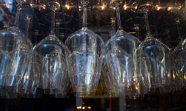 wine glasses hanging in bar (close-up) - küchenorganisation stock-fotos und bilder