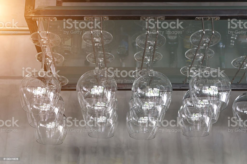 Wine glasses hanging in the wine shop. stock photo