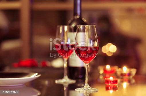 Wine glasses in the romantic settings. Fine dining concept.