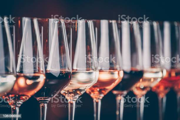 Wine glasses in a row buffet table celebration of wine tasting and picture id1084996534?b=1&k=6&m=1084996534&s=612x612&h=5ef0oijio6l4udxmobdvpv0fr68kzpas3tblxr63htm=