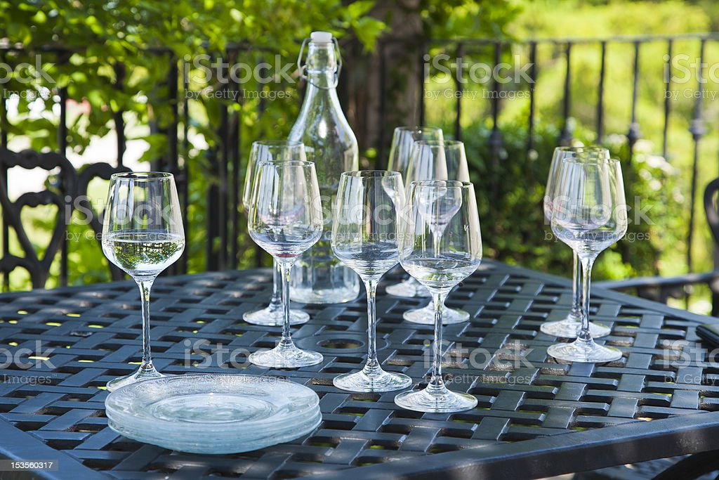 Wine Glasses on a Metal Table Outside stock photo