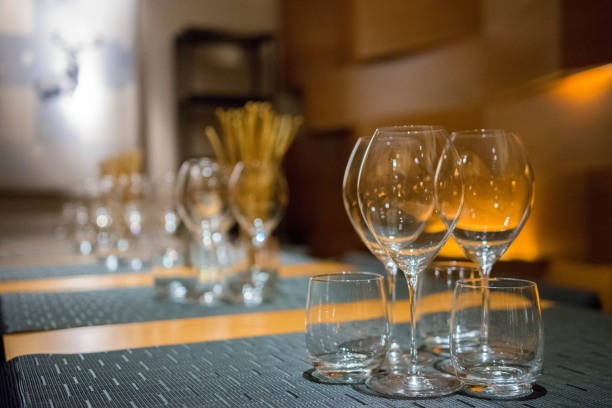 Wine glasses on a table stock photo