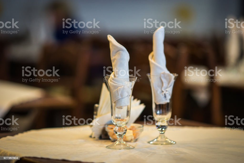 Wine glasses on a wooden table with white napkings Image of wine glasses on a wooden table with white napkings Beauty Stock Photo