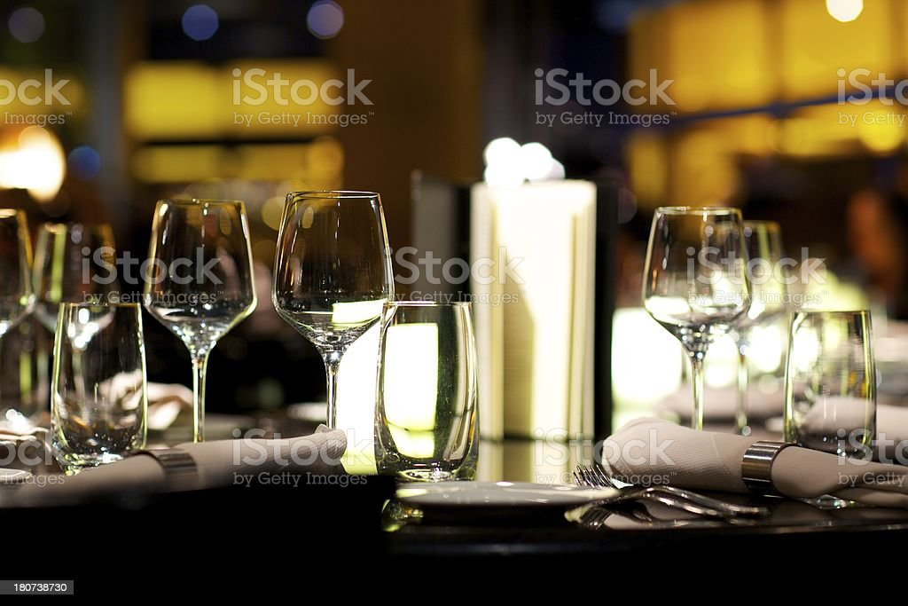 Wine glasses on dining table royalty-free stock photo