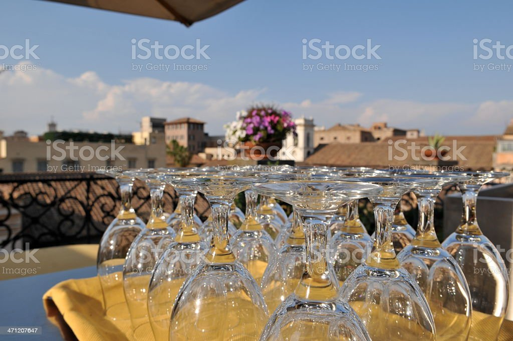 Wine glasses on terrace royalty-free stock photo