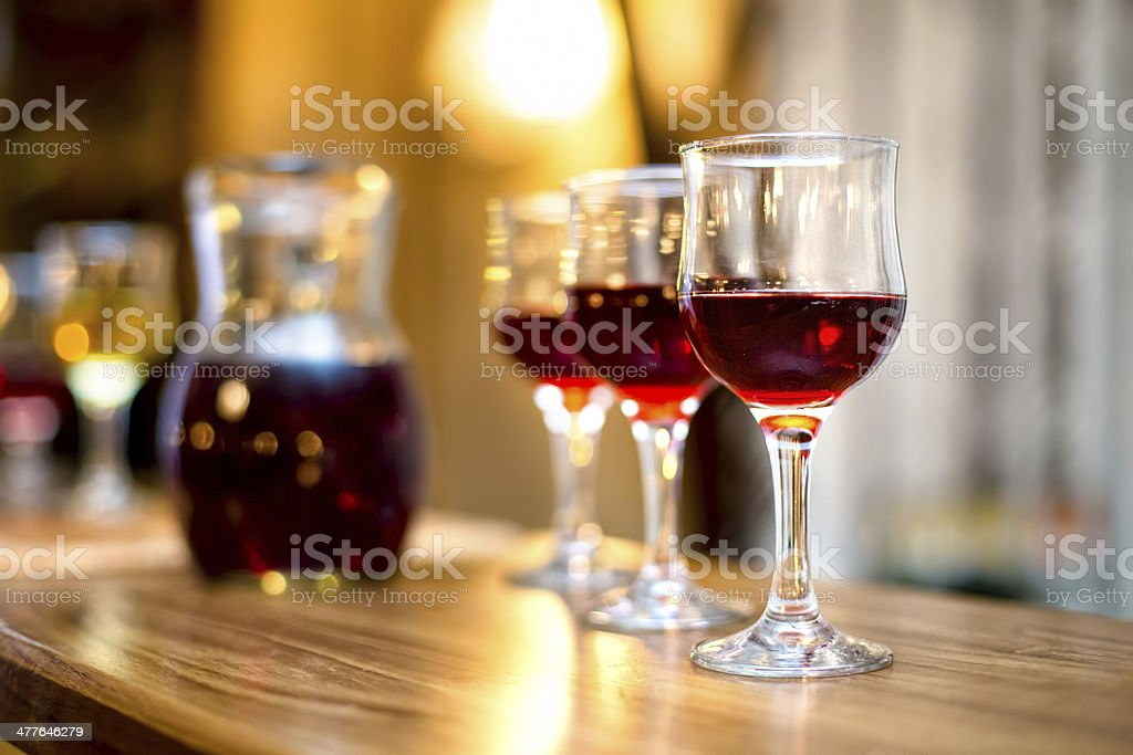Wine glasses with carafe and champagne at dinner cocktail party stock photo