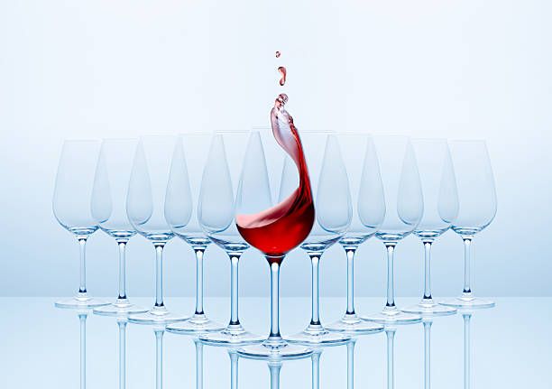 Wine glasses with red wine poured into the front glass Wineglass on a clean background! estudio stock pictures, royalty-free photos & images