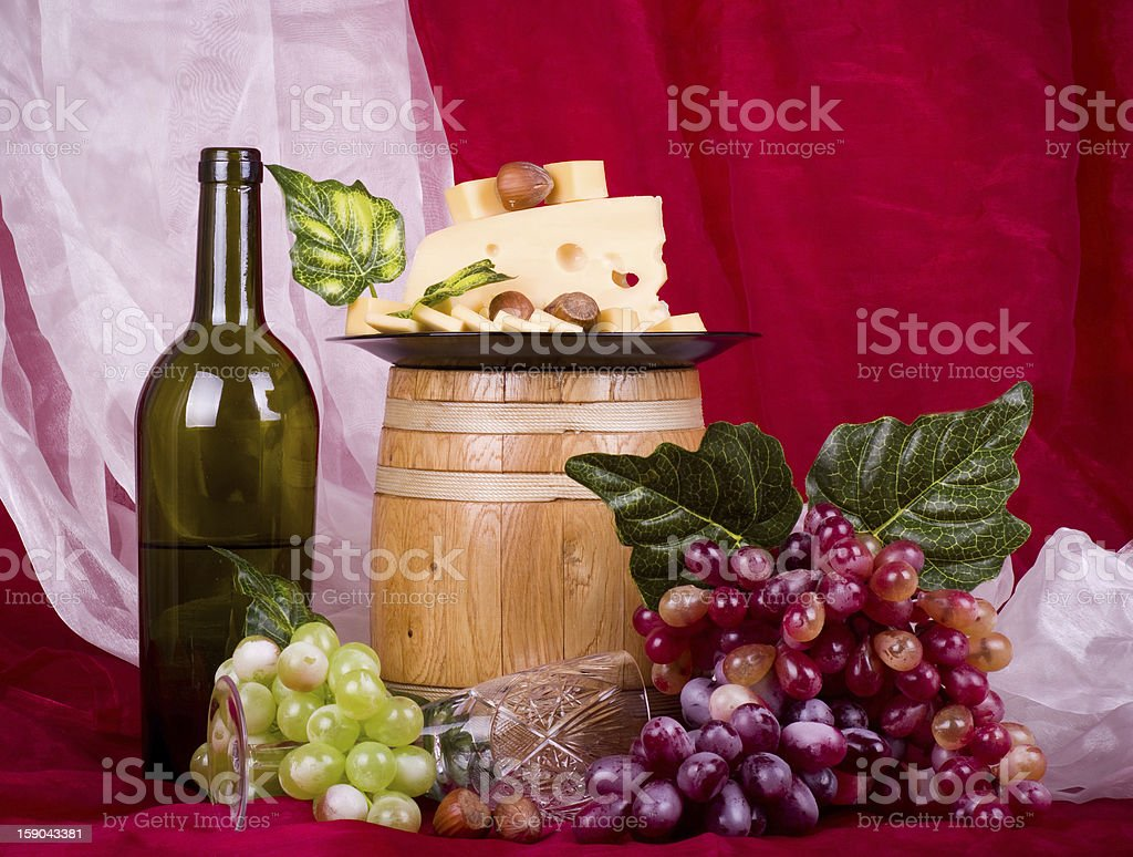 Wine, grape and cheese on red background royalty-free stock photo