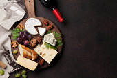 Wine, cheese, grape, bread and nuts. Top view with space for your text