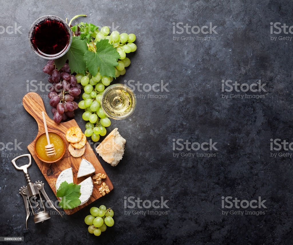 Wine, grape, cheese and honey stock photo