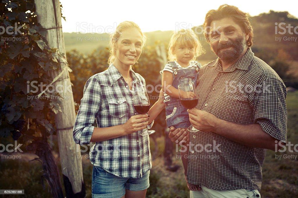 Wine grower family in vineyard stock photo
