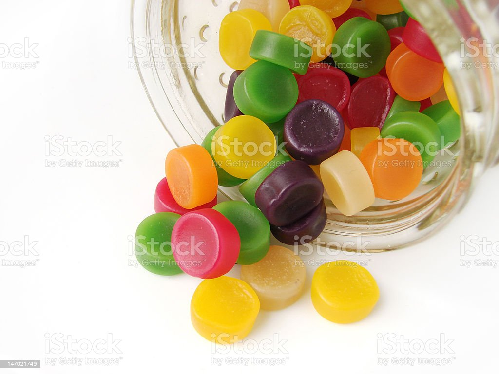 Wine gums falling out of the jar royalty-free stock photo