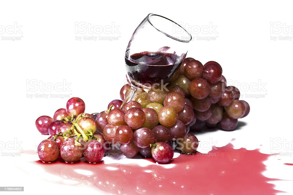 Wine in glass and red grapes on white background royalty-free stock photo