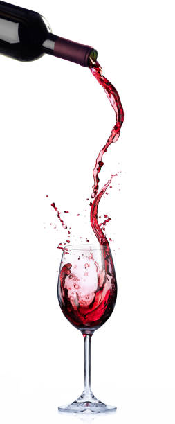 Wine In Motion And Splashing In Wineglass Wine List Design - Motion And Splashing In Wineglass pouring stock pictures, royalty-free photos & images