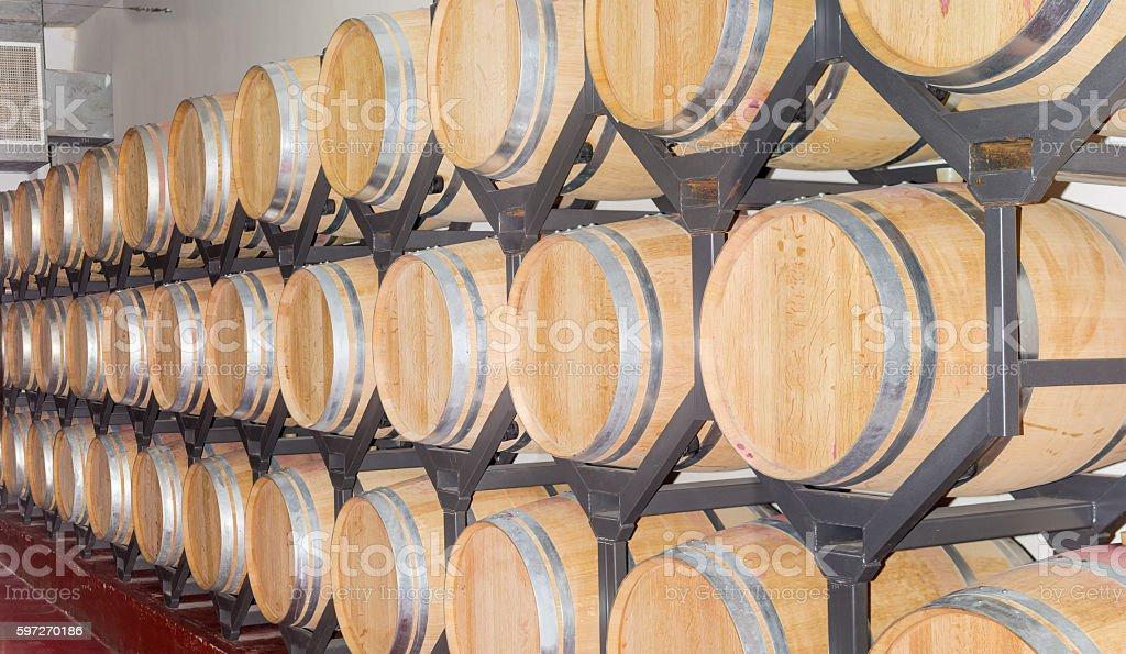 Wine in new oak barrels on a shelving royalty-free stock photo