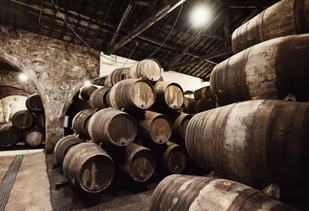 Wine in the old barrels stock photo