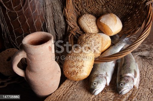 istock Wine jug with bread and fish 147705880