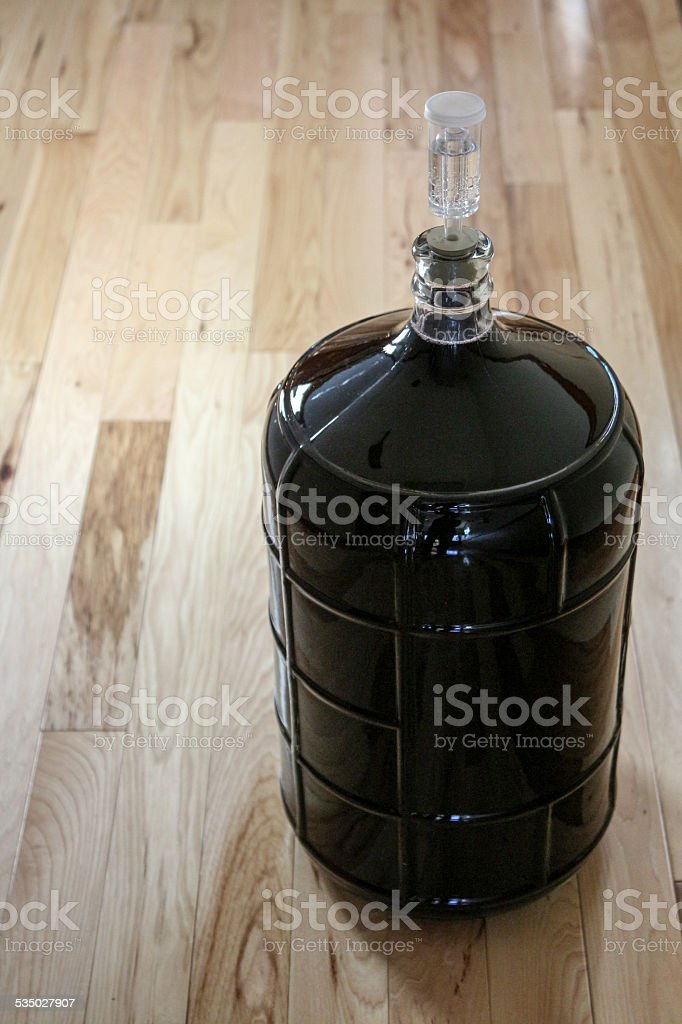 Wine Making Equipment - Carboy and Airlock on Wood stock photo