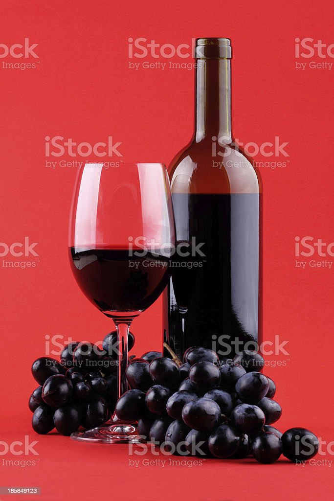 Wine on red background royalty-free stock photo